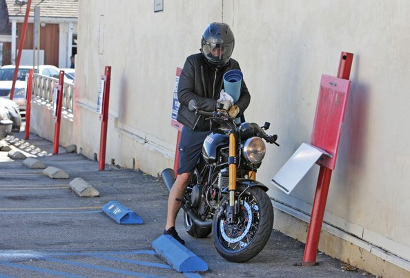 Orlando Bloom Orlando Bloom leaves a yoga class in Brentwood, wearing his motorcycle helmet, and jacket and toting his yoga mat.