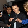 Orlando Bloom Signs Autographs at LAX