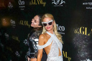 Megan Pormer and Paris Hilton are seen attending Paris Hilton + The Glam App Partnership Event in Los Angeles, California.