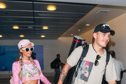 Paris Hilton and Chris Zylka are seen at Los Angeles International Airport in Los Angeles, California.