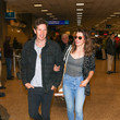 Paul Anderson Milla Jovovich Is Seen At Salt Lake City International Airport