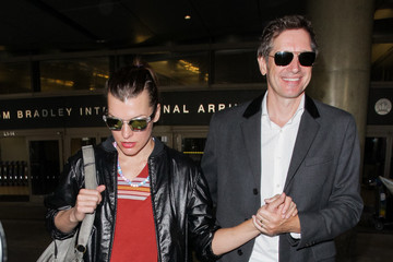 Paul W.S. Anderson Milla Jovovich And Paul W. S. Anderson At LAX International Airport