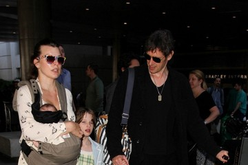 Paul W.S. Anderson Milla Jovovich and Family Are Seen at LAX