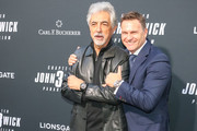 Joe Mantegna and Sascha Moeri are seen attending the 'John Wick Chapter 3 - Parabellum' premiere at TCL Chinese Theatre in Los Angeles, California.