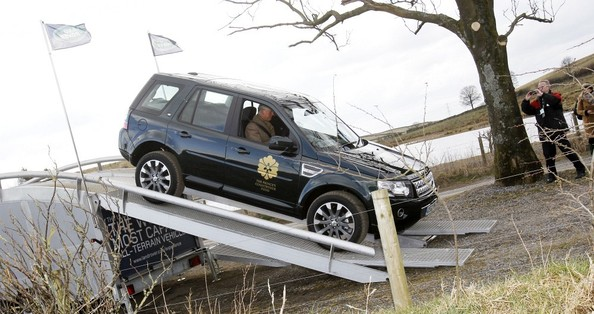 28th March, 2013:  The Prince of Wales drives a Land Rover Freelander during a visit to the Land Rover Experience driver training programme at Kitridding Farm, Lupton, Cumbria, where he announced the opening of the Land Rover Countryside Bursary Fund.