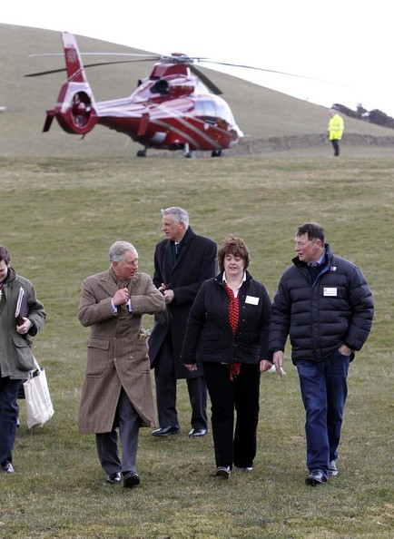 28th March, 2013:  The Prince of Wales arrives by helicopter during a visit to the Land Rover Experience driver training programme at Kitridding Farm, Lupton, Cumbria, where he announced the opening of the Land Rover Countryside Bursary Fund.