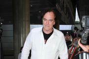 Quentin Tarantino Arrives at LAX