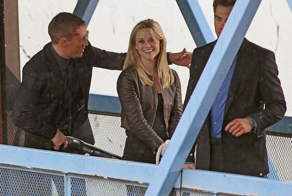 "***No CANADA RIGHTS***.While filming action scenes for the upcoming movie ""This Means War"" Reese Witherspoon plays the damsel in distress as she is bound at the wrists. Her gun wielding co-stars Chris Pine and Tom Hardy look worse for the wear with bloody make up on their faces."