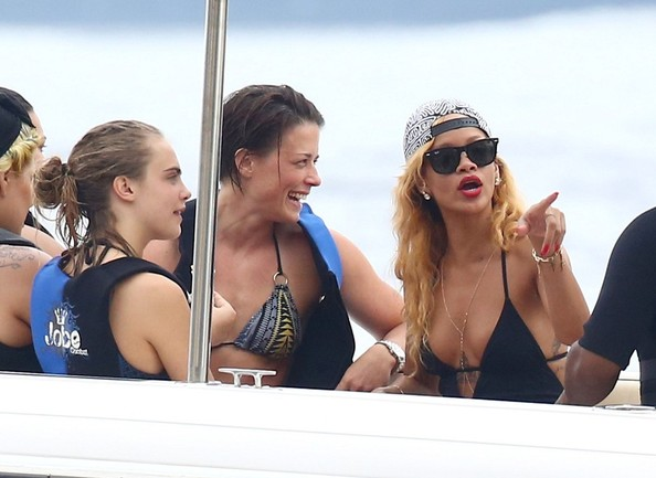 Rihanna and Cara Delevigne play in the ocean while vacation aboard a mega-yacht in the South of France. The party girls take shots of tequila and drink beers between swimming in the ocean, riding jet skis and being pulled on inner tubes behind a motorboat.