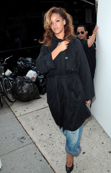 Rihanna Rihanna leaves her trailer in a bathrobe as she heads to a shoot during Mercedes-Benz NY Fashion Week.
