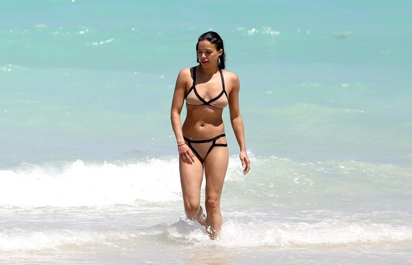 With her athletic body and Black hairtype without bra (cup size 34B) on the beach in bikini