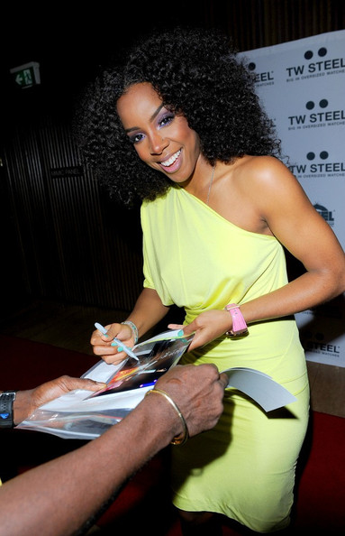 Kelly Rowland wears a bright yellow dress as she attends a photocall for TW Steel Oversized Watches who has named her as the company's worldwide ambassador.