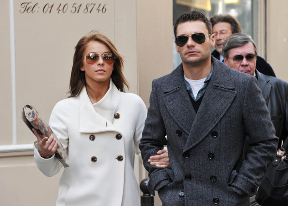 Ryan Seacrest and girlfriend Julianne Hough stroll through Paris even stopping to look at some real estate. The couple are joined by Ryan's mother Connie, sister Meredith and father Gary Seacrest.
