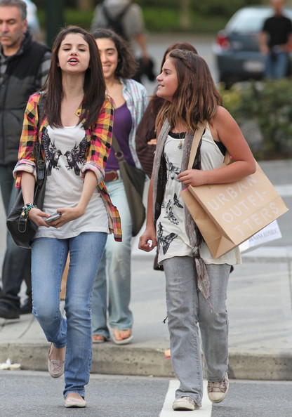 Selena Gomez Selena Gomez plays the dutiful girlfriend and hangs out with