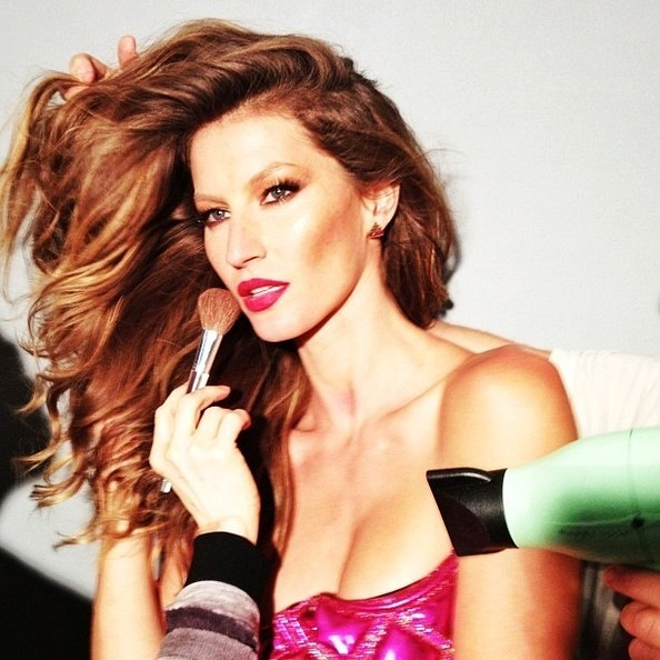 It takes a lot of people to turn Gisele Bundchen into GISELE!