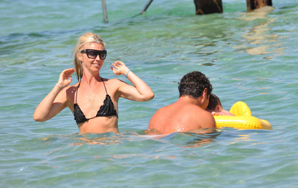 English socialite Tamara Beckwith is spotted splashing around in the water with husband Giorgio Veroni and their daughter Violet Angiolina Rose (b. January 28, 2009).