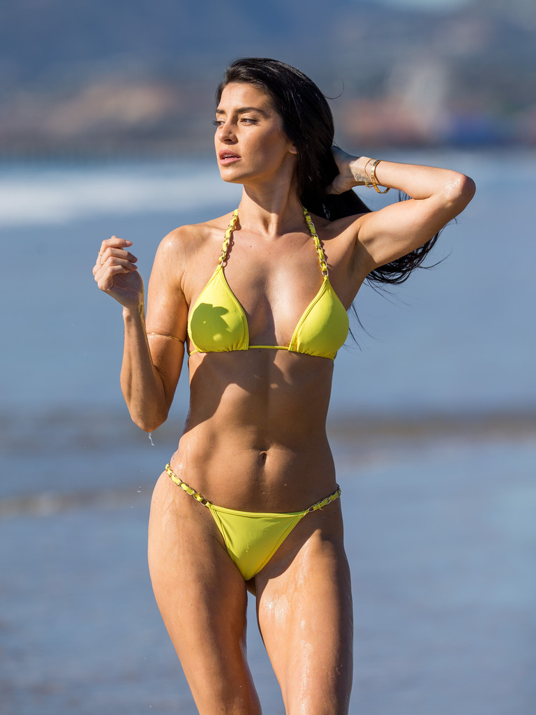 Nicole Williams In A Yellow Bikini On The Beach Zimbio
