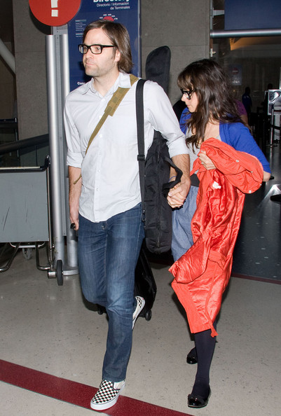 A very shy Zooey Deschanel arrives at LAX Airport wearing similar glasses as fiance Benjamin Gibbard.