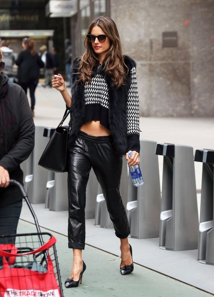Model Alessandra Ambrosio is all smiles while leaving the Victoria's Secret office in New York City, New York on November 5, 2013.