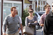 Former Governor Arnold Schwarzenegger and his kids Christina, Patrick and Christopher spotted out at the Brentwood Country Mart in Brentwood, CA.