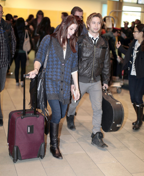 Ashley Greene Actress Ashley Greene and Jackson Rathbone arriving on a  flight from Los Angeles in 2ab7521806d