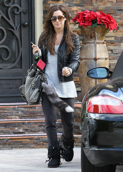 Actress Ashley Tisdale leaving her house and getting an iced coffee drink at the Coffee Bean & Tea Leaf before returning home in Toluca Lake, CA. Ashley has some frilly boots on and a raccoon tail hanging from her purse.
