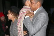 Couple Beyonce Knowles, Jay-Z and their daughter Blue Ivy Carter leaving the premiere of 'Annie' in New York City, New York on December 7, 2014. Blue Ivy did not look to happy to see all of the photographers.