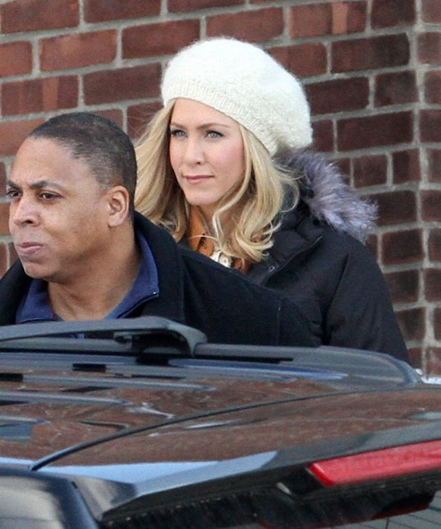 A Blonde Jennifer Aniston Is Escorted To Set