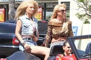 Pop star Britney Spears and rapper Iggy Azalea are spotted filming scenes for a new music video in Studio City, California on April 9, 2015. Both stars were rocking big hair and lots of denim during the 80's themed shoot!