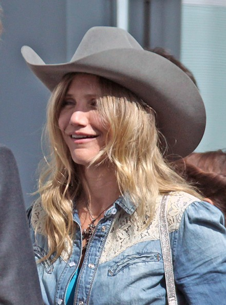 "Cameron Diaz and Colin Firth pictured on set filming ""Gambit"" at a London airport. Cameron was dressed as a cowgirl whilst Colin was dressed more conservatively."