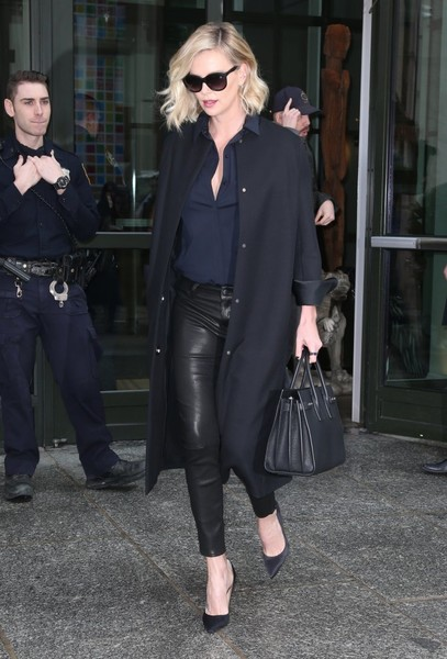 Charlize Theron kept it classic and stylish in a black wool coat while out and about in New York City.