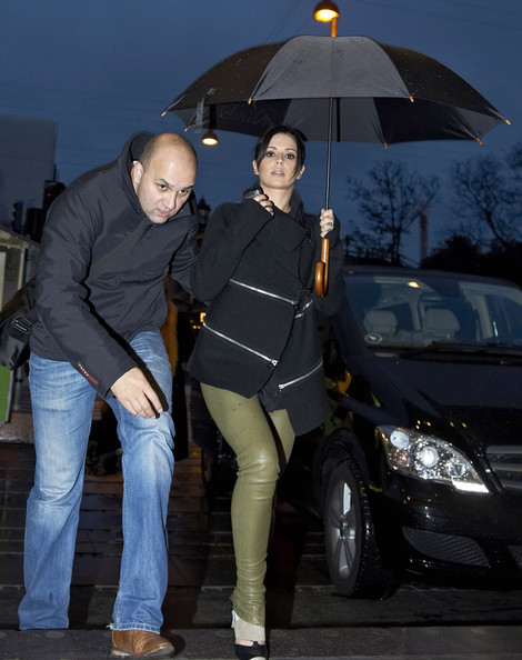British singer Cheryl Cole steps out on a rainy day in Denmark before her concert later that evening on September 24, 2012.