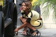 Christina Milian Puts Air in Her Tire