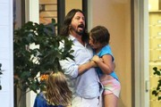 Foo Fighters frontman Dave Grohl and his wife Jordyn Blum take their two daughters Violet & Harper, along with their newborn baby, out for dinner at the Beverly Glen Center in Los Angeles, California on August 19, 2014.