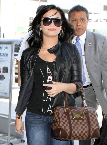 Demi Lovato Actress Demi Lovato arriving for a flight at LAX airport in Los Angeles, CA.