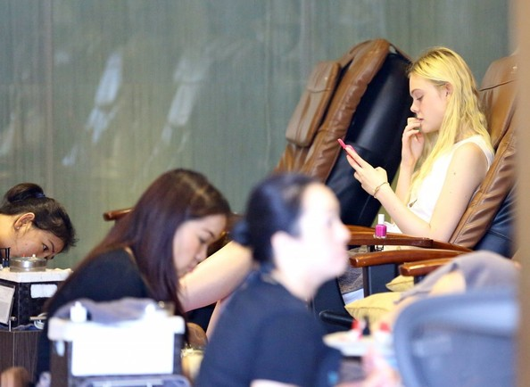 Elle Fanning Actress Elle Fanning stops to get a mani-pedi at Pure ...