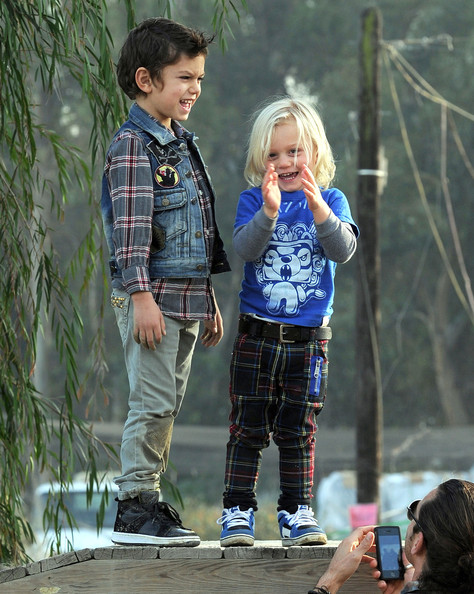Singer Gwen Stefani and Gavin Rossdale take their sons Kingston and Zuma to the Underwood Family Farms on New Year's Eve in Moorpark, CA. The kids played on a wooden fire truck and then the family fed the goats.