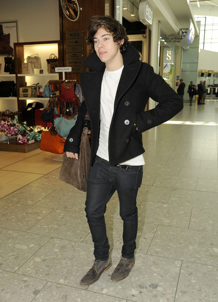 One Direction's Harry Styles catches a flight out of Heathrow Airport to Los Angeles on May 1, 2012 in London, England.
