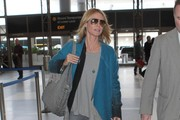 Heidi Klum Catches a Flight at LAX Airport