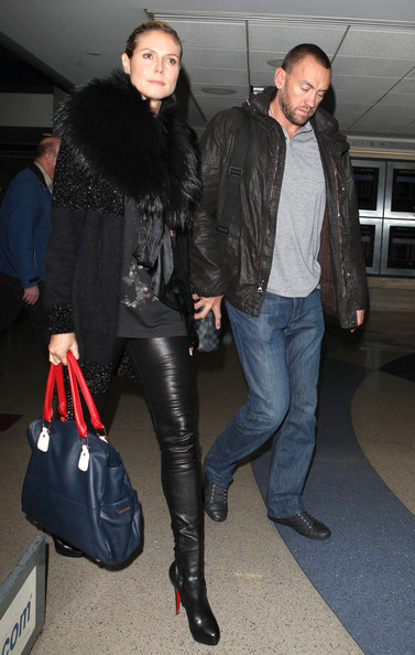 Model Heidi Klum and her boyfriend/bodyguard Martin Kristen arriving on a flight at LAX airport in Los Angeles, California on November 1, 2012.