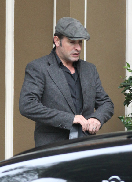 Jean dujardin in jean dujardin exits his hotel with his for Jean dujardin parents