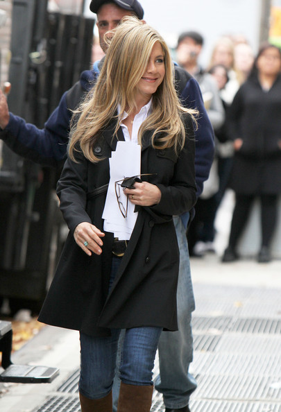 Actress Jennifer Aniston waves to photographers on the set of 'Wanderlust' in New York City