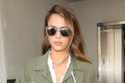 Actress and business woman Jessica Alba arrives on a flight at LAX airport in Los Angeles, California on October 24, 2015.