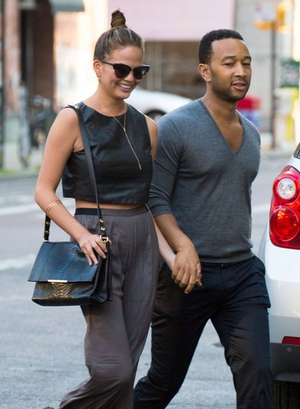 "Singer John Legend and his model wife Chrissy Teigen going out to dinner in Soho in New York City, New York on July 12, 2014. Chrissy was recently featured in her husband's newest music video for the song ""You & I (Nobody in the World)"" that celebrates female beauty."