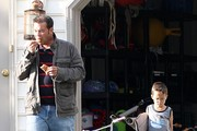 This is the first time in a few weeks where Jon Gosselin is seen outside playing with his children in Reading, PA. He gave them hugs, kisses, spun then around on his shoulder and took care of them when they got hurt. He also used his blackberry and looked at his snowboards.