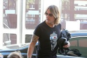 Singer Keith Urban makes a Starbucks run before heading to LAX Airport to catch a flight out of town with his daughters on March 13, 2015 in Los Angeles, California.