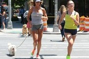 Kelly Bensimon goes for a morning jog with her daughter Sea Louise and their dog on June 23, 2014 in New York City, New York.