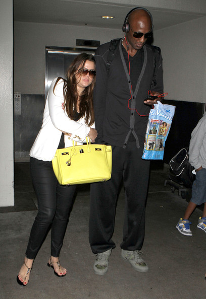 Khloe Kardashian, Lamar Odom and his two kids Destiny and Lamar Jr. arriving on a flight at LAX airport in Los Angeles, CA.