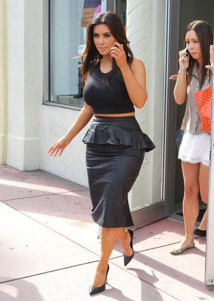 Kim and Kourtney Kardashian are spotted strutting out of their Dash boutique in Miami