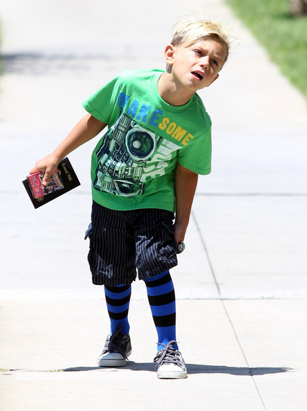 Kingston Rossdale Gwen Stefani's kids Kingston and Zuma spotted out with their nanny in Studio City, CA. Kingston was looking under a newspaper stand for something and the got some 'Harry Potter' playing card. Zuma was showing off his American spirit and his fake tattoo's on his legs.